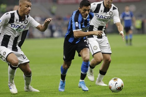 Alexis Sanchez challenges for the ball with Udinese's Antonin Barak.