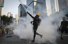 Tear gas and water cannons used against Hong Kong democracy protesters