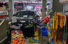 Man in his 40s arrested after car crashes through Dublin shop