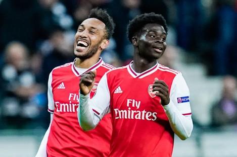 Bukayo Saka (right) celebrates a goal.