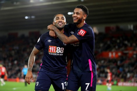 Callum Wilson (left) celebrates scoring his side's third goal of the game with Bournemouth's Joshua King.