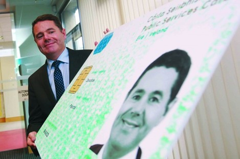 File photo. Minister Paschal Donohoe posing with a large-size PSC.