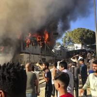 Greece says it wants to begin returning 10,000 migrants after deadly fire sparks riots