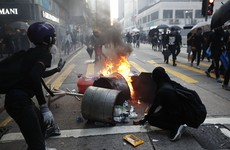 Protester shot by police as violence escalates in Hong Kong