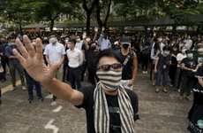 Hong Kong: Anger as masks ban at rallies following months of protests