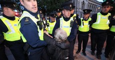 Extinction Rebellion protesters moved by gardaí during sit-in outside Dáil