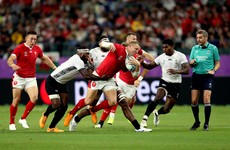 Wales secure quarter-final berth after bruising battle against Fiji