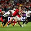 Wales secure quarter-final berth after bruising battle against Fiji