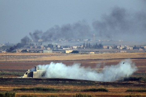 Smoke billows from targets inside Syria during bombardment by Turkish forces.