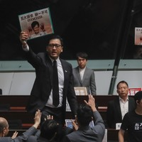 'Carrie Lam step down!': Chaotic scenes in Hong Kong legislature as hecklers shout down major speech