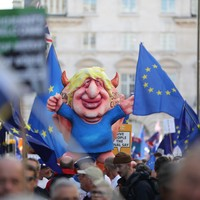 Tens of thousands of anti-Brexit protesters march in London as MPs delay decision