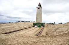 120-year-old lighthouse put on wheels to move it away from eroding Danish coastline
