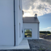 'It's all white - except for the pink front door': Inside a farmhouse-style self-build completed just two months ago