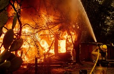 Tens of thousands flee their homes as US emergency services battle fierce wildfires