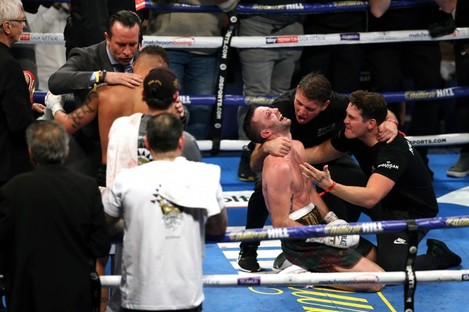Josh Taylor celebrates winning the super-lightweight unification at the O2 Arena, London.