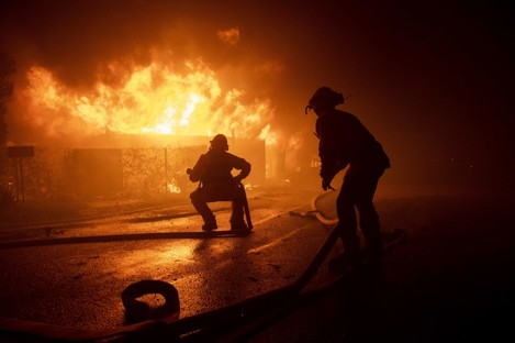 Firefighters in California tackling the wildfires.
