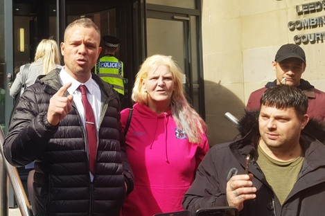 Defendant Phillip Hoban (left) addressing his supporters outside Leeds Crown Court