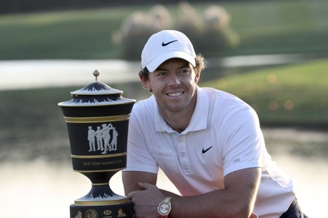 McIlroy with the trophy.