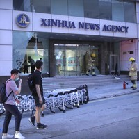 Chinese news agency slams 'barbaric' attack on its Hong Kong office by protesters