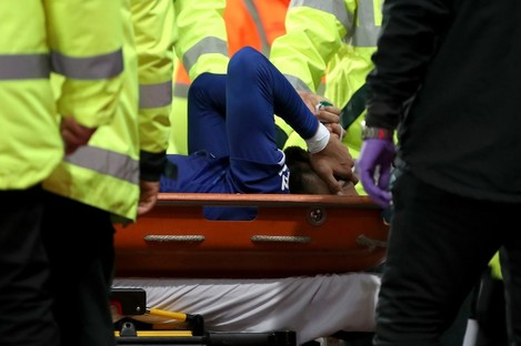 Everton's Andre Gomes is carried off the field by medical staff.