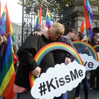 LGBT couples stage 'kissing protest' outside Dáil to demand hate crime legislation