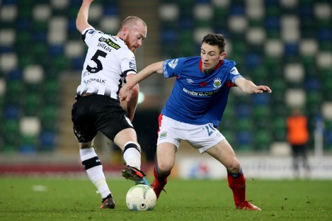 Dundalk's Chris Shields and Linfield's Stephen Fallon in action during last Friday's first leg tie in the cross-border Unite the Union Champions Cup.
