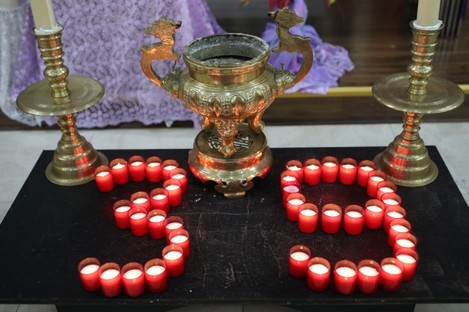 Candles at a mass and prayer vigil for the 39 victims in Essex earlier this month.