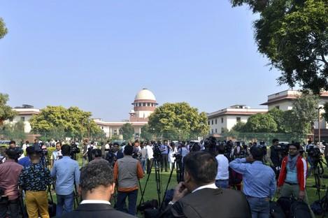 Crowds gather outside the Supreme Court in New Delhi.
