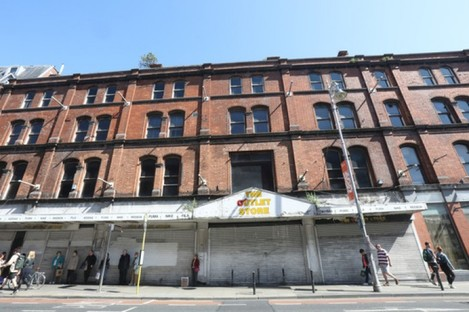 A red-brick building on George's street which has been bought to make into a hotel. The number of hotels across Dublin has become a target of criticism from housing activists.