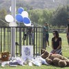 Teenager who killed two students in US school shooting dies as police still hunt for motive