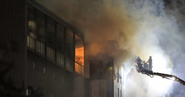 Investigation under way after fire which spread 'extremely rapidly' at student accommodation in UK