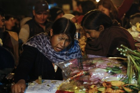 Women mourn over the coffin of a supporter of former President Evo Morales killed during clashes with security forces in Sacaba.
