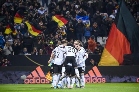 Germany players celebrate Leon Goretzka's goal.