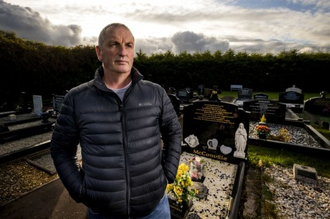 Michael McConville, son of IRA murder victim Jean McConville, at her grave.