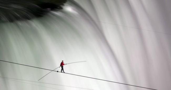 In pictures: Daredevil successfully walks tightrope across Niagara Falls