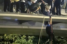 Hong Kong: Student protesters escape police siege by climbing down ropes to waiting motorbikes