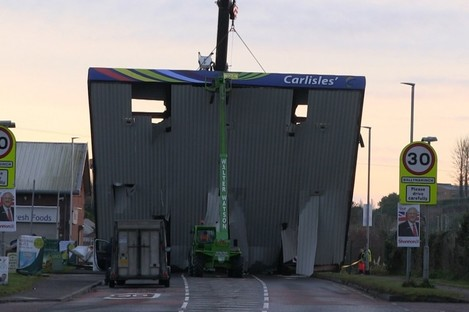 A recovery crane removing the forecourt roof after the raid at Carlisle's filling station early this morning.