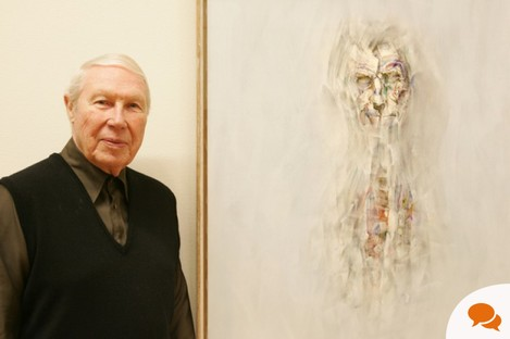 Louis le Brocquy beside one of his portraits of Samuel Beckett in 2006.