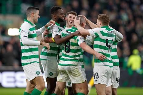 Celtic's Scott Brown (centre right) celebrates scoring his side's second goal.
