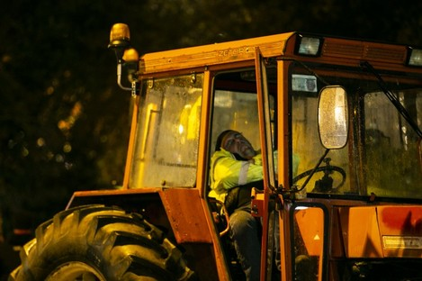Farmers sleep in the cabs of their tractors outside the Shelbourne hotel.