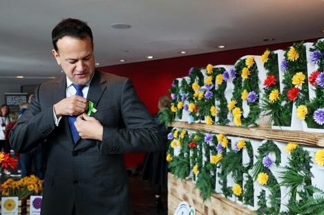 Taoiseach Leo Varadkar pinning on a Green Ribbon as part of See Change's mental health campaign