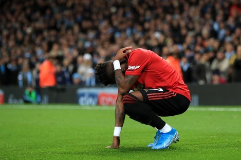 Manchester United's Fred reacts after being hit by thrown objects.