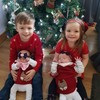 'Screaming babies and poo explosions': Lorraine shares the reality of this festive family snap