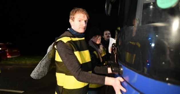 Extinction Rebellion protesters dressed as bees glue themselves to Tory campaign bus
