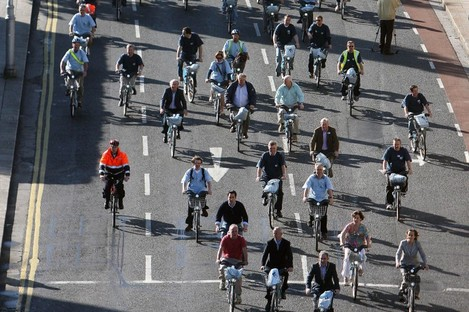 Cyclists on Dublin bikes crossing the river Liffey