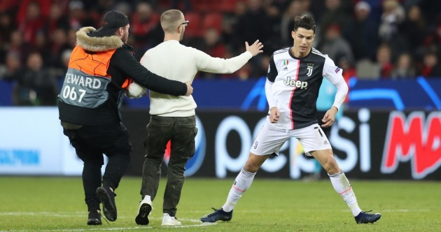 Double trouble as Cristiano Ronaldo rages at selfie-hunting pitch invader