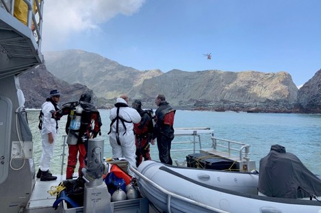 Police divers preparing to search the waters near White Island.