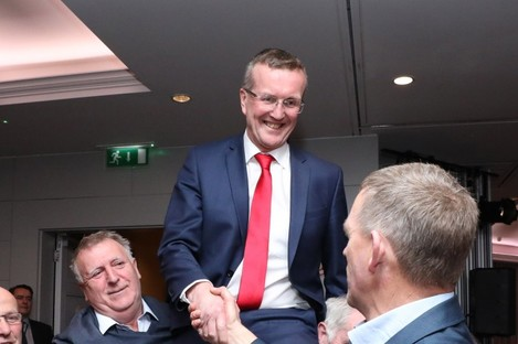 Tim Cullinan celebrating his win while being congratulated by his closest rival in the contest John Coughlan.