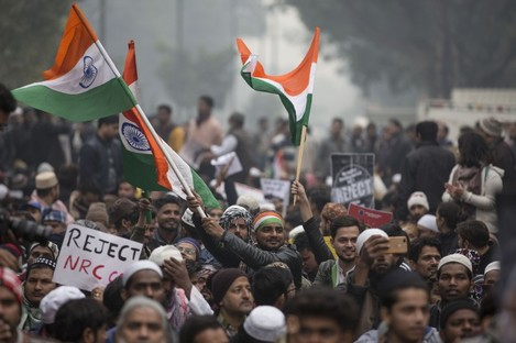 People participate in a protest against the new citizenship law in New Delhi, India