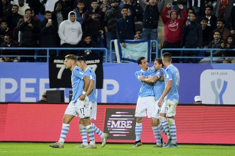Lazio players celebrate after they score during their Super Cup match against Juventus.